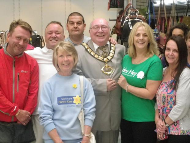 Widnes Market traders with the Mayor of Halton Clr Shaun Osborne, Linda Shard from Marie Curie Cancer Care and Helen Hughes from Alder Hey Children's Hospital