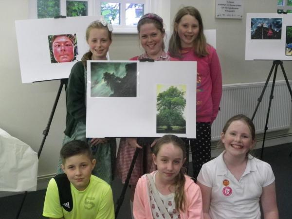 Young Hale villagers with their photographs