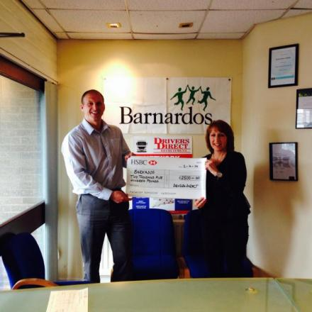 Gethin Roberts, managing director of Drivers Direct presents £2,500 to Jane Harries from Barnardos