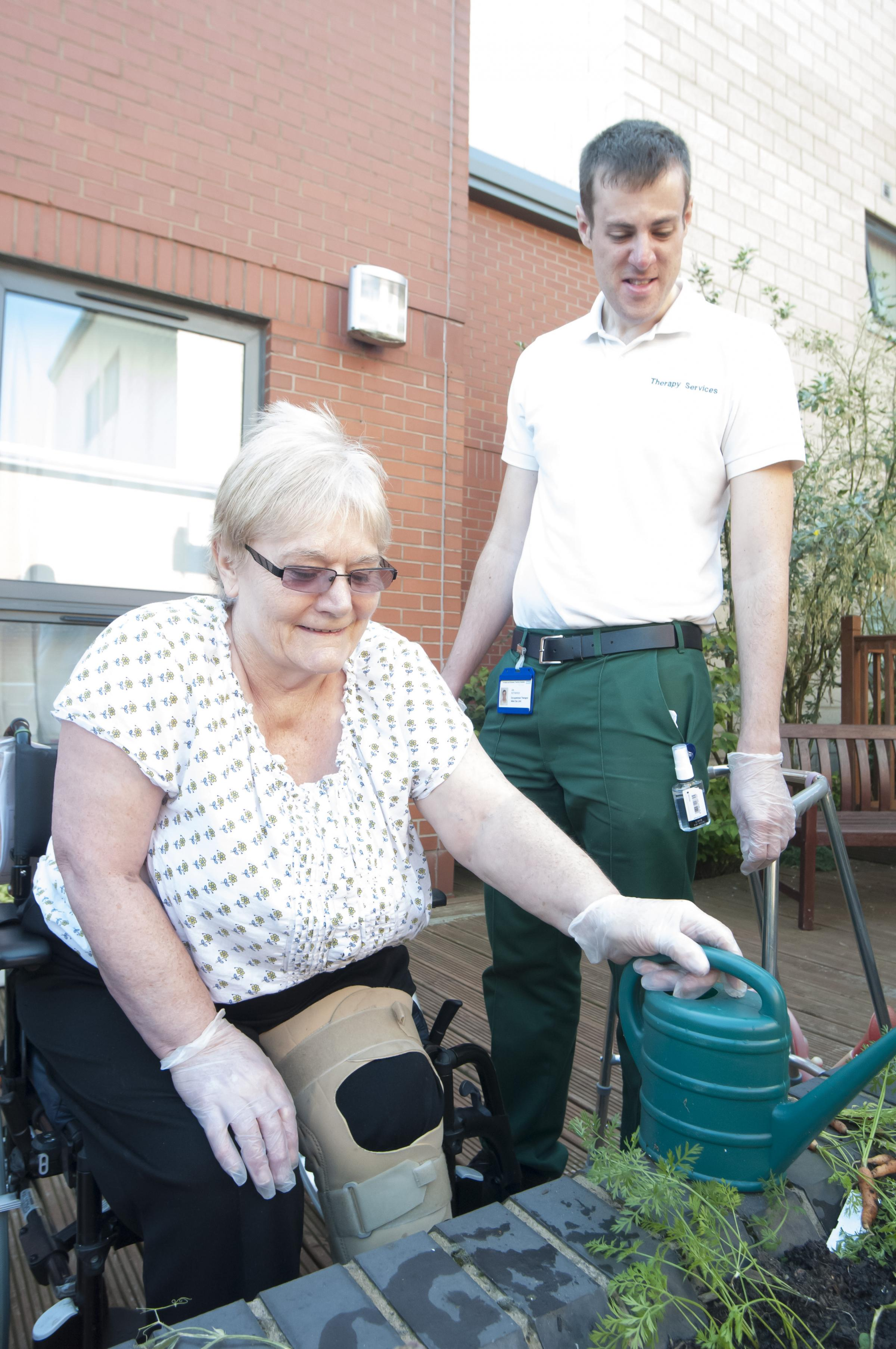 Mary Dennett learns new gardening skills with Ian Rotheroe, specialist occupational therapist