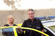 Jane Unsworth from 5 Boroughs with PC Mark Jenkins from Operation Emblem DGW101014