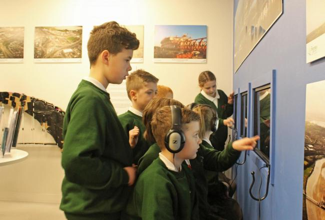 St  Mary's pupils using the interactive screens at the Mersey Gateway information centre in Runcorn Shopping Centre