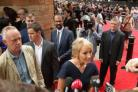 JK Rowling speaks to media upon arriving for the opening gala performance of Harry Potter And The Cursed Child, at the Palace Theatre in London