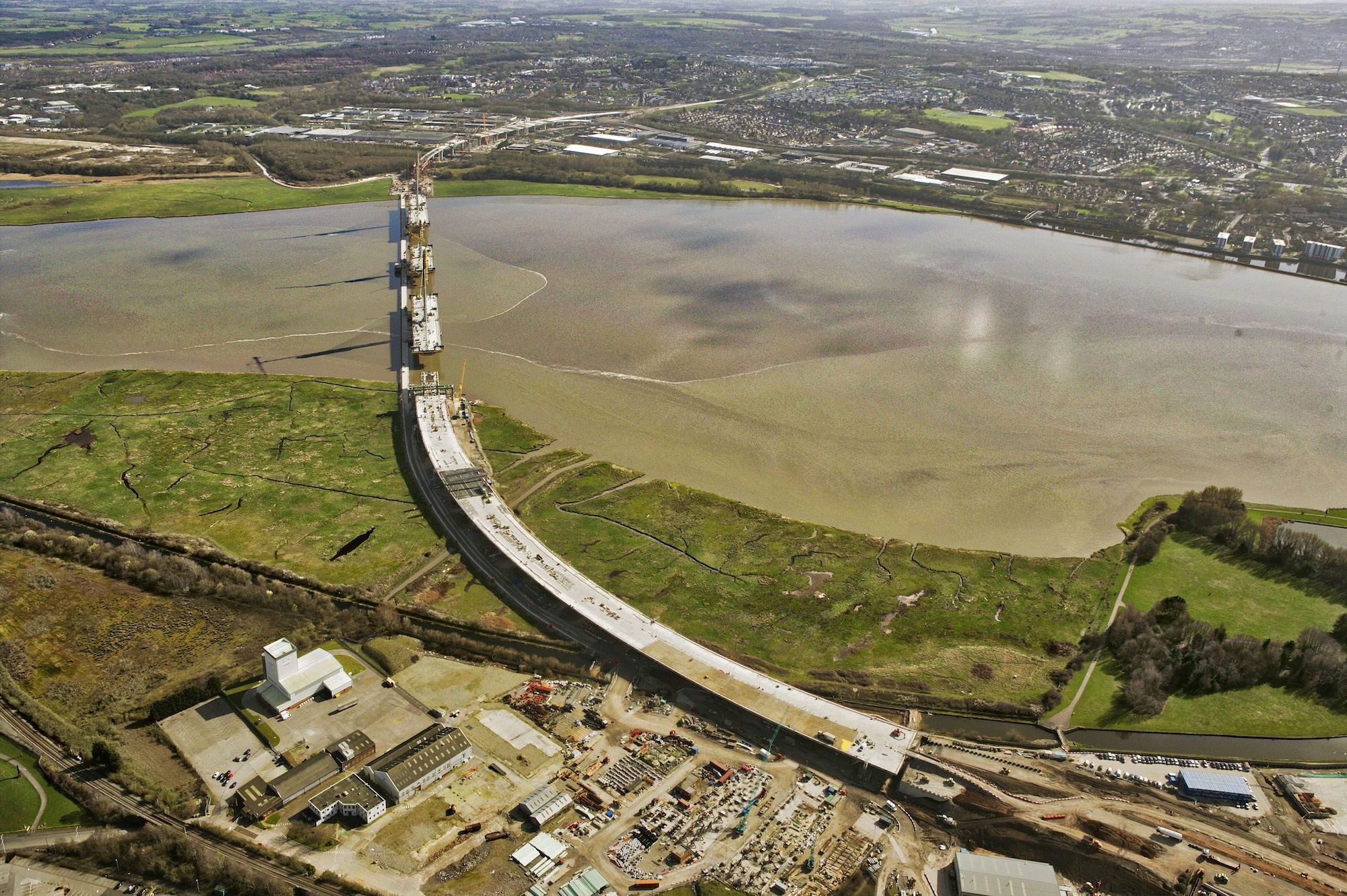 The giant north approach viaduct across the Widnes saltmarsh is now complete