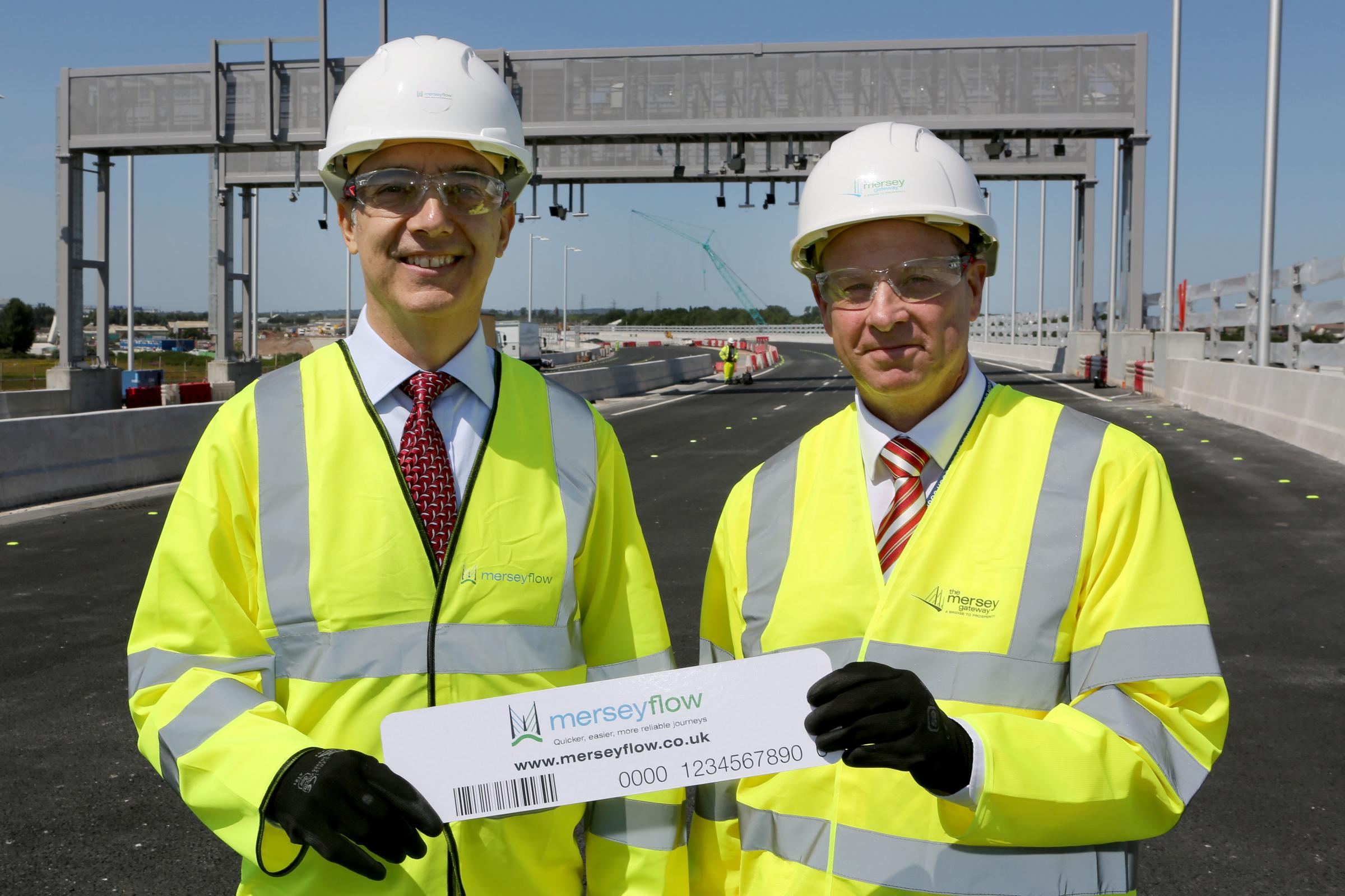 Anthony Alicastro, managing director of merseyflow, and David Parr, chief executive of Halton Council, at the opening of tolling registration on the Mersey Gateway