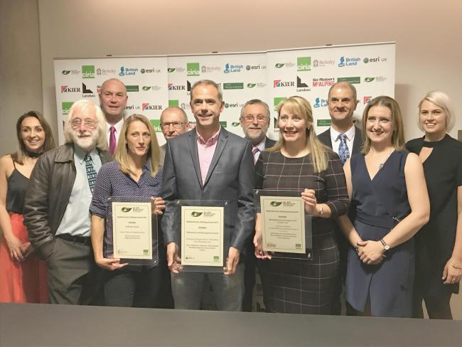 Victoria Pollard, fourth from right, Merseylink environment manager, proudly shows off her award