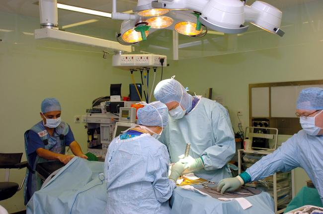 Surgeons performing spinal surgery