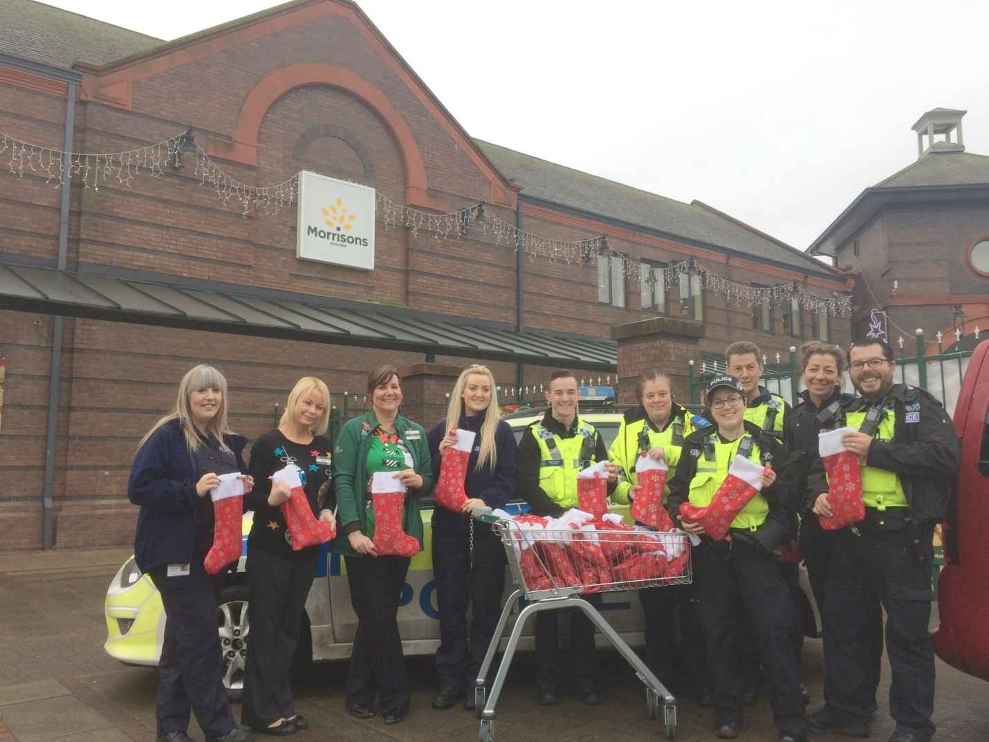 Staff from Morrisons donate gifts for the vulnerable and elderly Widnes Local Policing Unit and Cheshire Fire and Rescue