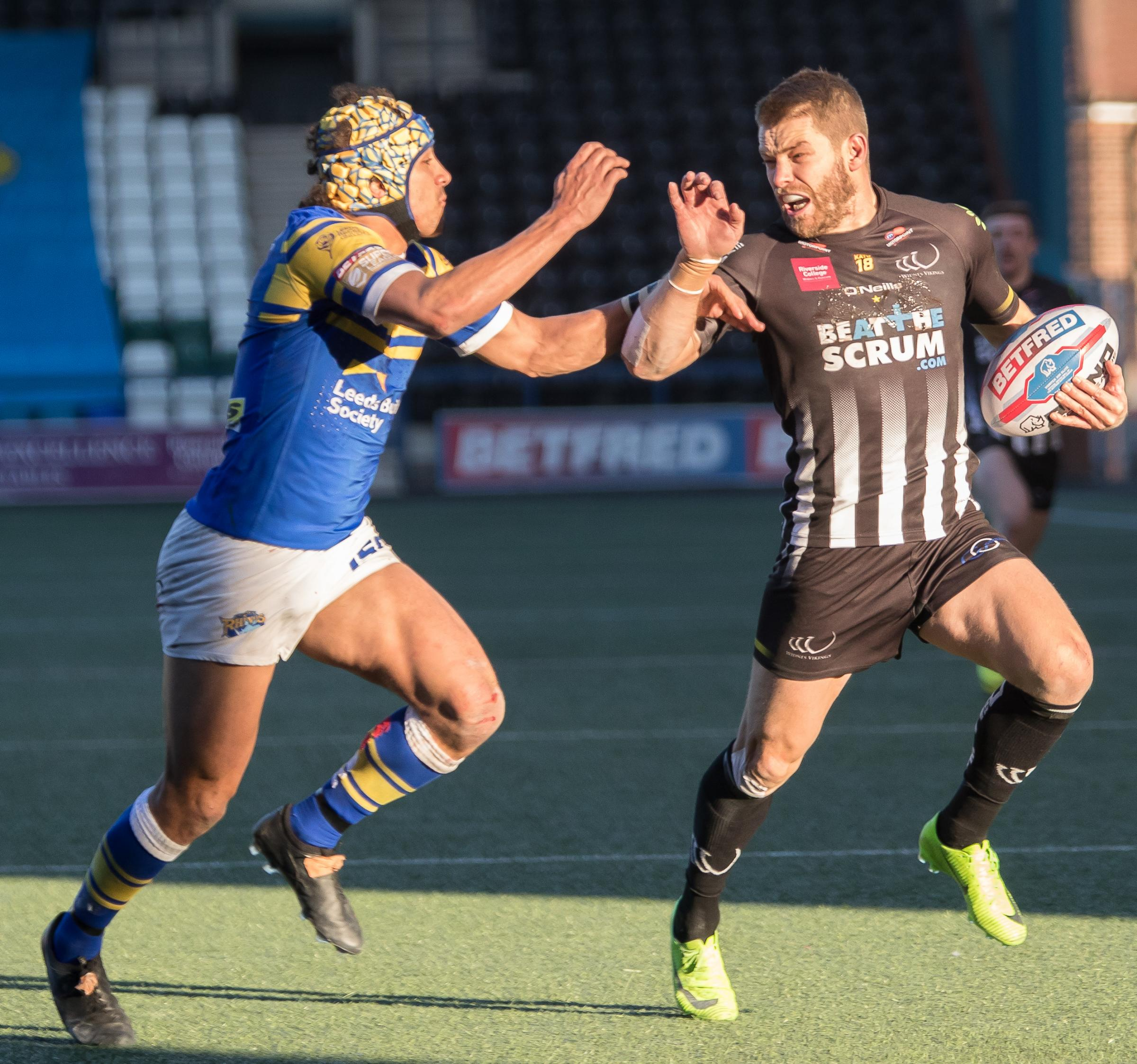 Rhys Hanbury makes a break against Leeds. Picture: Richard Walker