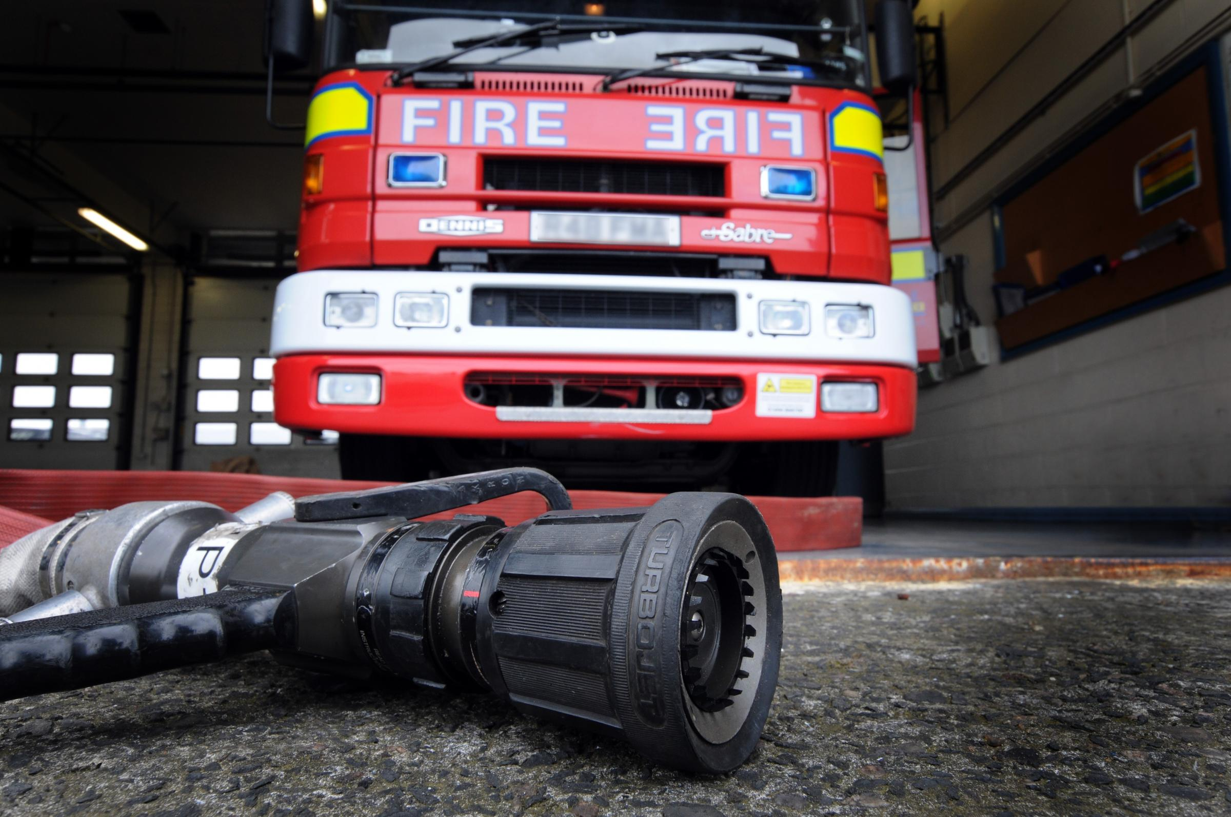 Firefighters tackle digger fire on Warrington Road