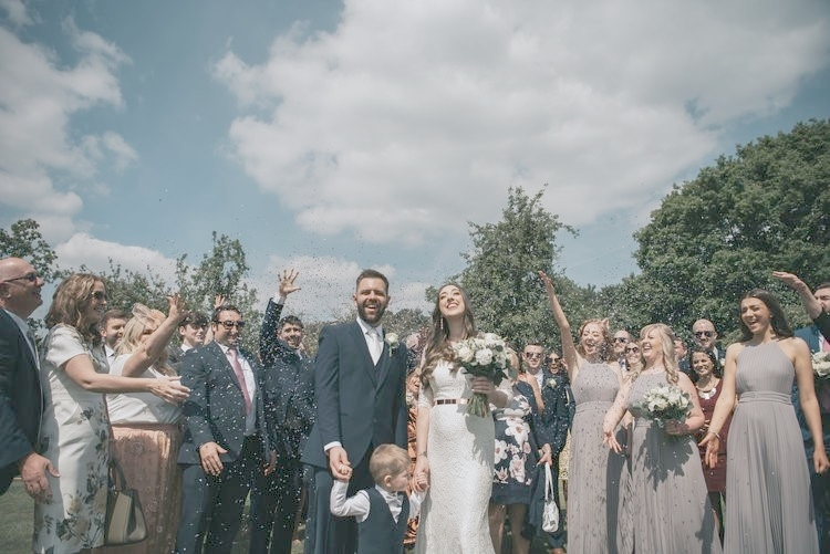 Newly weds Richard and Kate Berry and son Lucas celebrate with family and friends in the walled garden of Runcorn's Norton Priory (Picture: Adam Roberts)