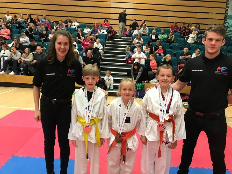 Medal winner Aaron Webster joins successful martial arts students at the annual Matt Fiddes Martial Arts Northern Championships