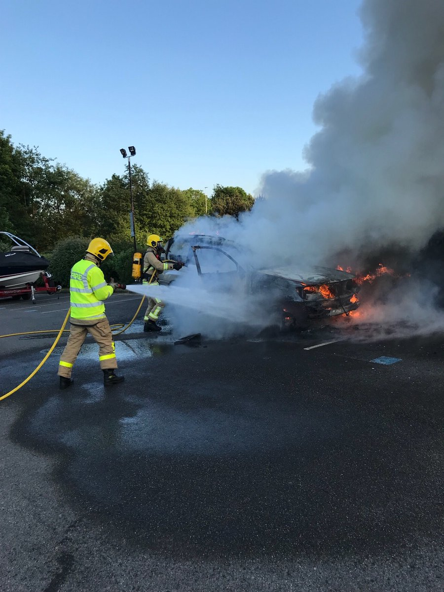 Firefighters tackle car fire at Daresbury Park in Runcorn