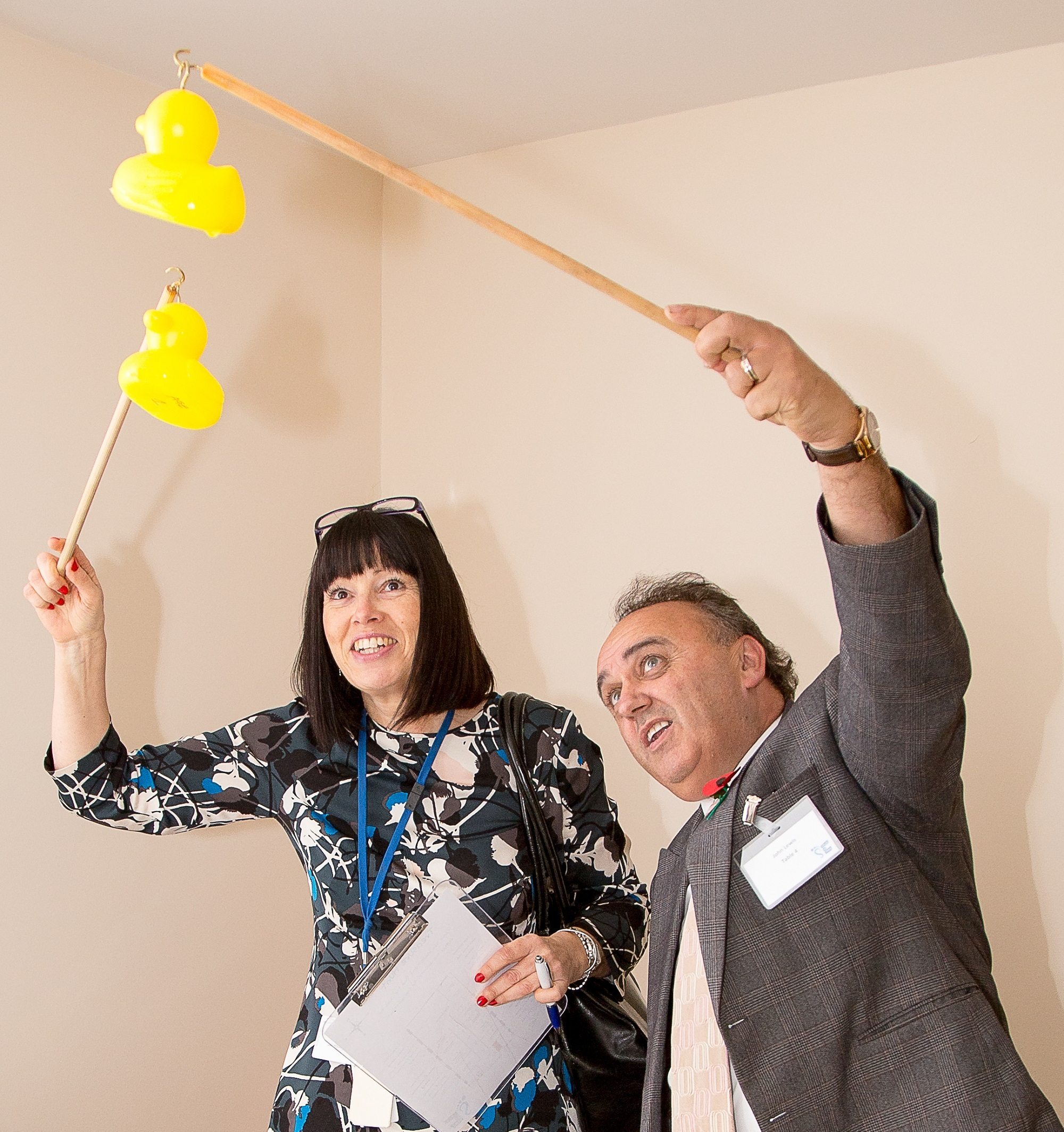 Lesley Lunt, sales and marketing manager from SOG Ltd alongside John Lewis, managing director of SOG Ltd having a go at hook a duck