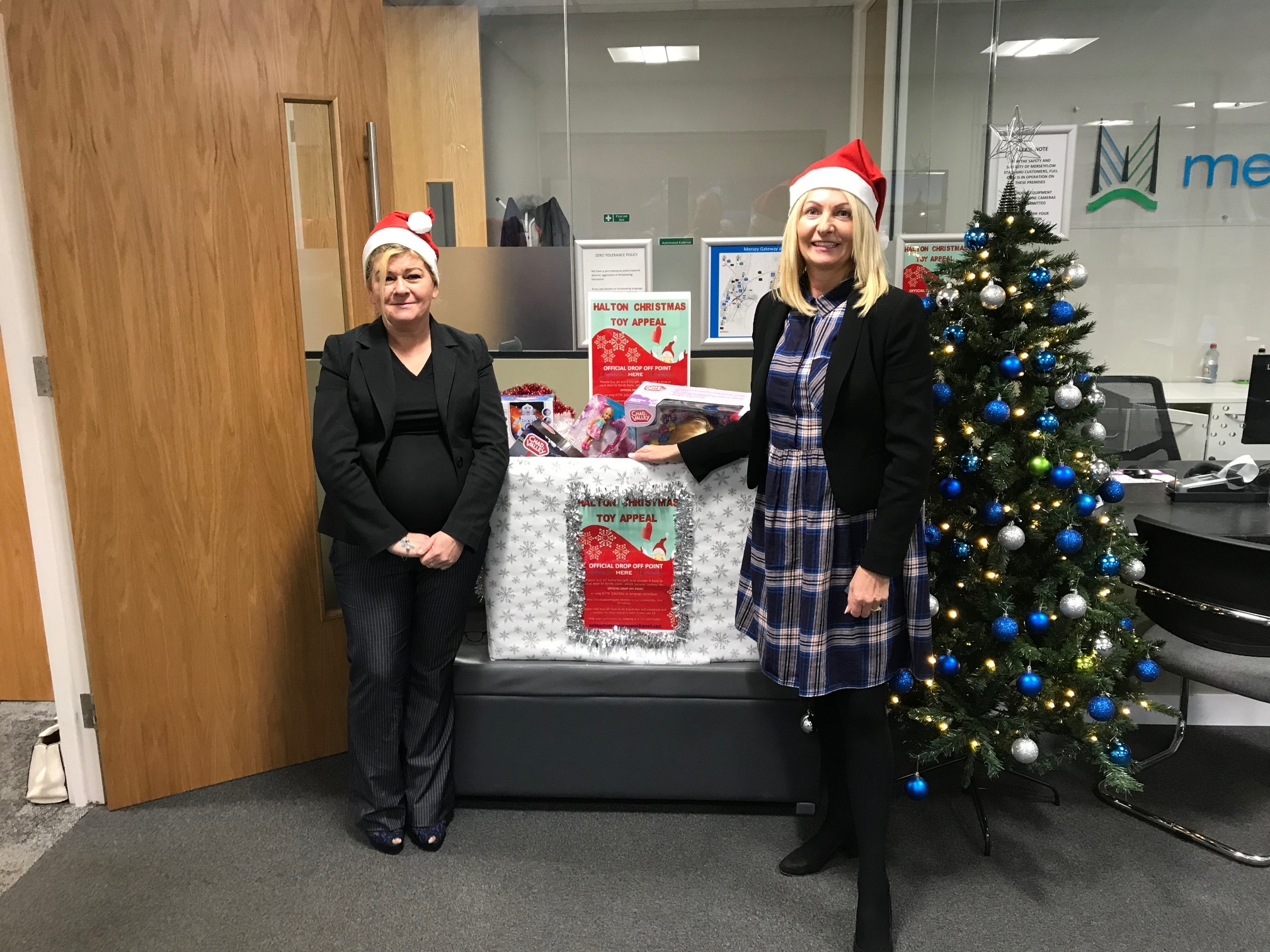 Left, Nicky Woodward from the Halton Christmas Toy Appeal and Helen Williams, marketing manager with merseyflow