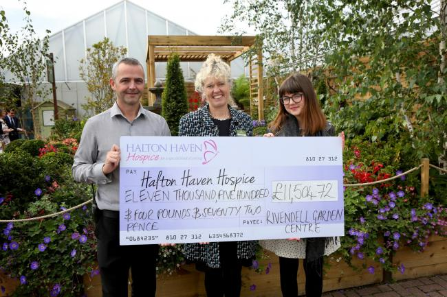 Caroline Notcutt and Notcutts Rivendell centre manager David Quigley present a cheque to Faye O'Neill from Halton Haven Hospice.