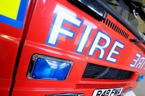Investigation after fire at business premises
