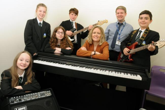 From left; Sandymoor School pupils Heather Coleman, Ruby Wilson, Grace Harvey, Ethan Byrne and Andrew Gorrell with Creamfields' Gill Nightingale and music teacher Simon Ashcroft